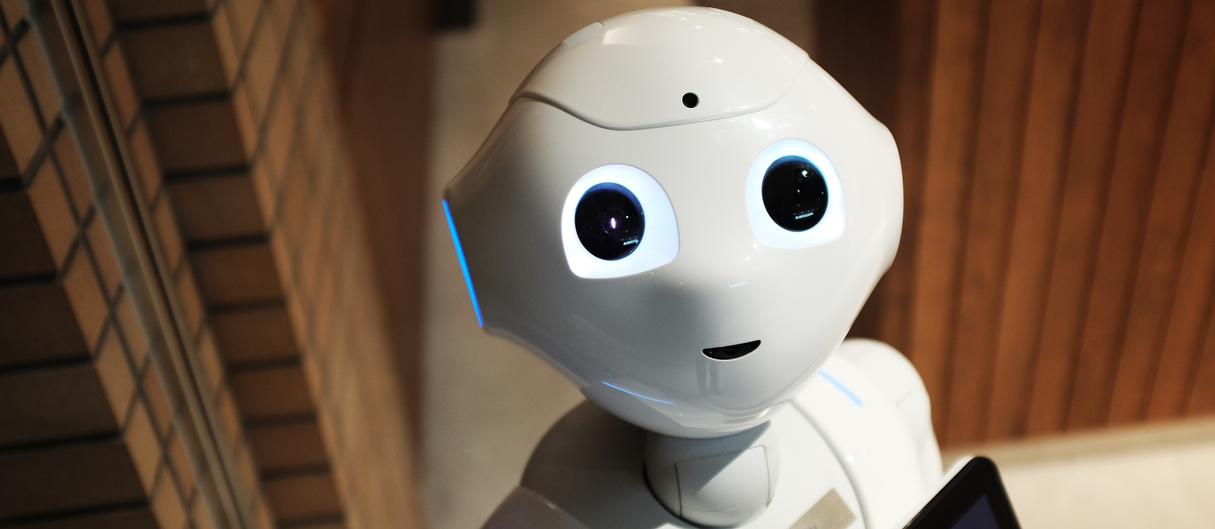 robot named pepper holding an iPad