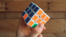 hand holding rubiks cube